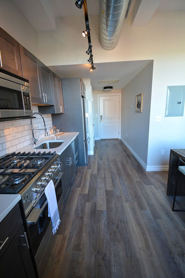 Hardwood flooring throughout kitchen and entry
